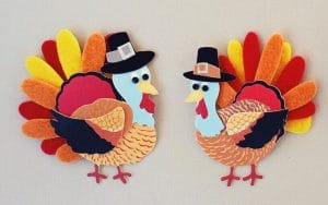 Two decorative felt turkeys to celebrate Thanksgiving